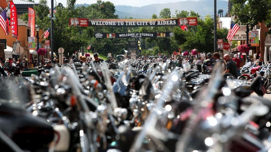 FILE - In this Aug. 1, 2014 file photo, the city streets of Sturgis are lined with motorcycles days before the official kickoff of the annual Sturgis Motorcycle Rally in Sturgis, S.D. Preparations are under way for the landmark 75th anniversary rally beginning Monday, Aug. 3, 2015, where organizers are planning for up to one million people. (AP Photo/Toby Brusseau, File)