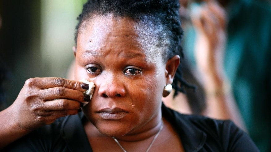 Louis Karluah, mother of Barway Collins, has  tears wiped from her eyes after attending the court hearing of Pierre Collins, father of Barway,  on Monday, Aug. 3, 2015 in Minneapolis, Minn. Collins, charged with killing his 10-year-old son and throwing the boy in the river has been sentenced to 40 years in prison.  (Jerry Holt /Star Tribune via AP)  MANDATORY CREDIT; ST. PAUL PIONEER PRESS OUT; MAGS OUT; TWIN CITIES LOCAL TELEVISION OUT
