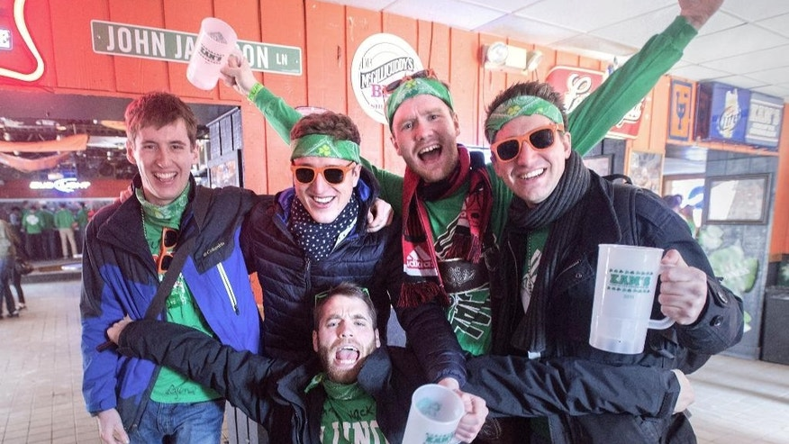 In this March 6, 2015 photo, a group of unofficial St. Patrick's Day party goers celebrate at Kam's in Champaign, Ill. The University of Illinois has partied its way into the top spot on an annual list of top party schools in the country. The Urbana-Champaign campus has been among the top five on the Princeton Review's annual list for years but is No. 1 on the new list released Monday Aug 3, 2015. (Rick Danzl/The News-Gazette via AP) MANDITORY CREDIT