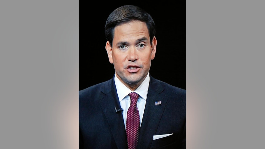 Republican presidential candidate, Sen. Marco Rubio, R-Fla., shown on a video screen from C-SPAN's Washington studio, speaks during a forum Monday, Aug. 3, 2015, in Manchester, N.H. (AP Photo/Jim Cole)