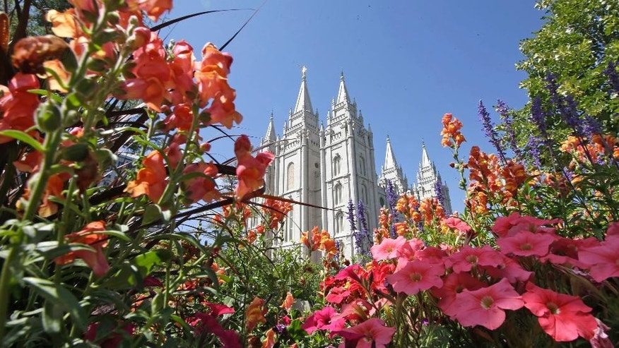 Flowers bloom in front of the Salt Lake Temple Tuesday, Aug. 4, 2015, at Temple Square, in Salt Lake City. The Mormon church is taking another step in its push to be more transparent, and is releasing more historical documents that shed light on how Joseph Smith formed the religion. (AP Photo/Rick Bowmer)