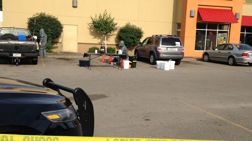 Tuesday, Aug. 4, 2015: Emergency responders examine hazardous materials in the parking lot of a Cedar Rapids Taco Bell where the remnants of a meth lab were found.