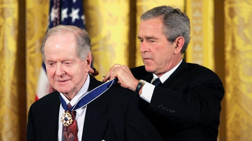 FILE- In this Nov. 9, 2005, file photo, President George W. Bush presents the Presidential Medal of Freedom to historian Robert Conquest, left, in Washington. Conquest, whose influential works on Soviet history shed light on the terror during the Stalin era, has died. Conquest's wife, Elizabeth Neece, said he died Monday, Aug. 3, 2015. He was 98. (AP Photo/Evan Vucci, File)