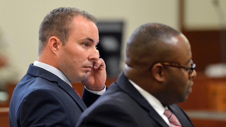 Police officer Randall Kerrick listens during his trial at the Mecklenburg County Courthouse in Charlotte, N.C., Tuesday, Aug. 4, 2015. Kerrick is facing voluntary manslaughter charges in the shooting death of Jonathan Ferrell. (Davie Hinshaw/The Charlotte Observer via AP, Pool)