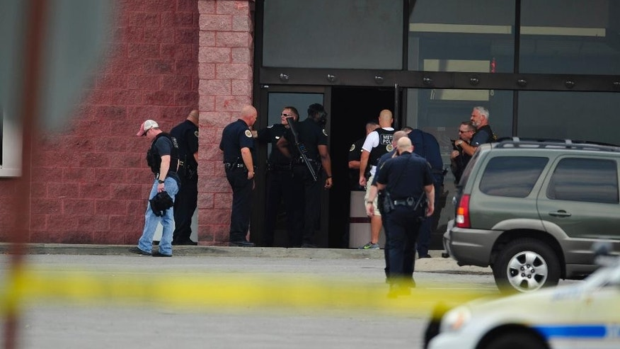 CORRECTS DATELINE TO ANTIOCH, NOT NASHVILLE - Police work the scene of a reported shooting in Antioch, Tenn., Wednesday, Aug. 5, 2015. A suspect wielding a hatchet and a gun inside a Nashville-area movie theater died after exchanging gunshots with a police team that stormed the theater, police said Wednesday. (John Partipilo/The Tennessean via AP) MANDATORY CREDIT NO SALES