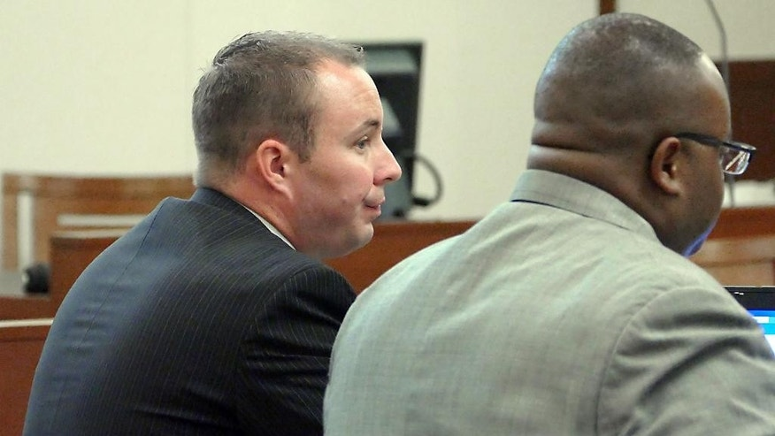 Officer Randall Kerrick, left, sits with defense attorney Michael Greene during day two of  his trial at the Mecklenburg County Courthouse in Charlotte, N.C., Tuesday, Aug. 4, 2015. Kerrick is facing voluntary manslaughter charges in the shooting death of Jonathan Ferrell. (Davie Hinshaw/The Charlotte Observer via AP, Pool)