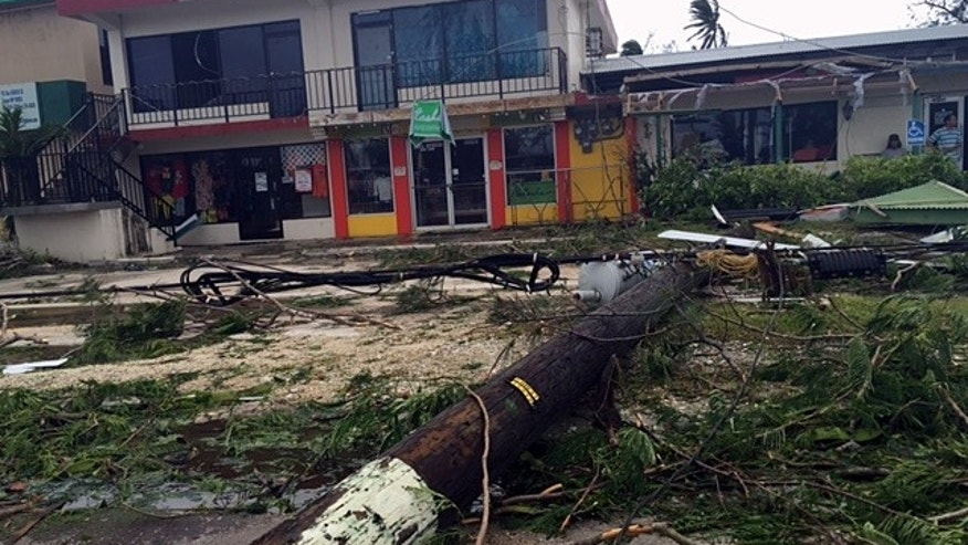This Monday, Aug. 3, 2015 photo provided by Svetlana Hunter shows the storm damage to a shopping area in Saipan, Northern Mariana Islands. Residents of Saipan are without water and electricity and are rationing gasoline — four days after Typhoon Soudelor hit the most populated island in the U.S. territory of the Northern Marianas on Sunday. (Svetlana Hunter via AP)