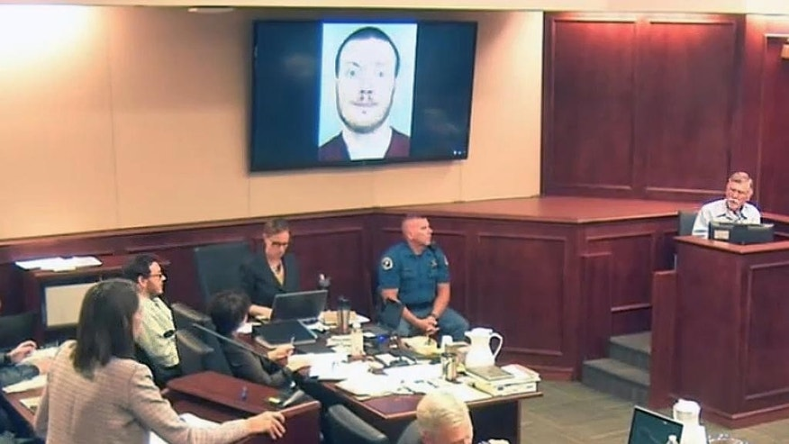 Defense attorney Tamara Brady, left, questions Robert Holmes, top right, the father of James Holmes, background left, during the sentencing phase of the Colorado theater shooting trial.