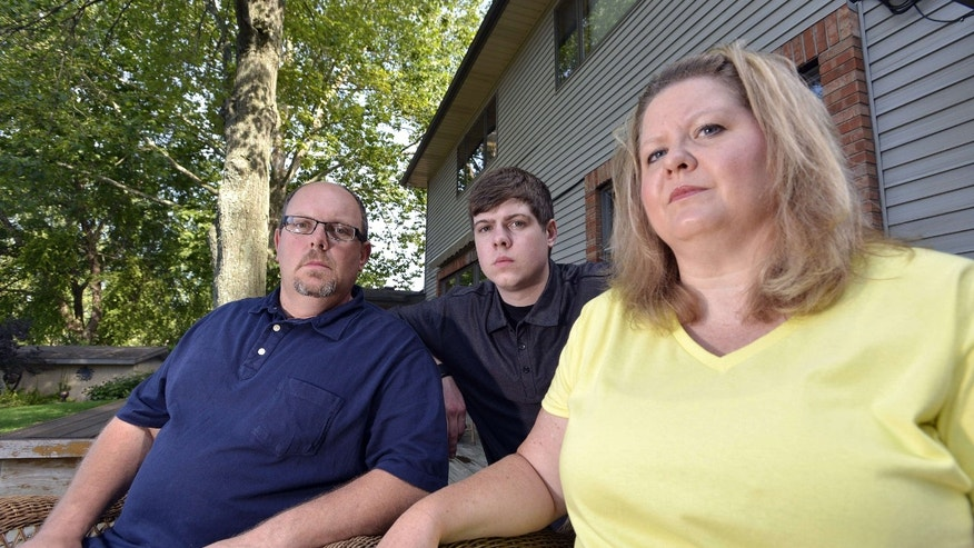 July 22, 2015:  Zach Anderson, center, and his parents, Les and Amanda Anderson, pose for a photo at their home in Elkhart, Ind. Zach and his parents are embroiled in a legal battle with a Niles, Mich.