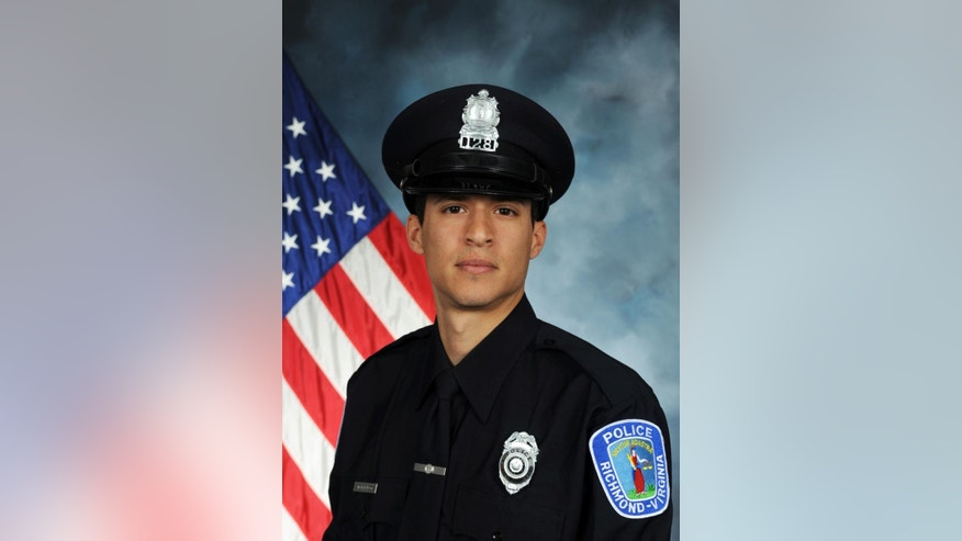 This image provided by the Richmond (Va.) Police Department shows officer Ryan Bailey. The Richmond police chief says an armed suspect who was killed in a shootout with police fired first and his two officers were justified in returning fire. In the Wednesday night, Aug. 5, 2015, shooting, officer Bailey, who is black, was wounded in the arm. The other officer was Jacob DeBoard.   (Richmond Police Department via AP)