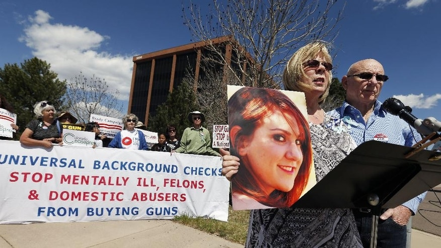 """FILE - In this April 23, 2014 file photo, Lonnie Phillips, right, and his wife Sanday, whose daughter Jessica Ghawi was killed by James Holmes in the 2012 Aurora movie theatre massacre, speak at a rally against gun violence in front of Republican Congressman Mike Coffman's office, in Aurora, Colo. Should Holmes be sentenced to death, Lonnie Phillips says he worries about the decades of appeals. """"If I had my way, he would go to prison the rest of his life and not have to go through the appeals process where we have look at his face and hear his name again,"""" Phillips said. """"We want him behind us."""" (AP Photo/Brennan Linsley, file)"""