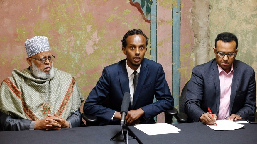 Aug. 6, 2015: Imam Sheikh Sa'ad Musse Roble, left, and Jibril Afyare, right, listen as Abdimalik Mohamed, chairman, addresses a news conference outlining how their task force is working with the U.S. Attorney on a pilot project designed to combat terror recruiting in Minneapolis.