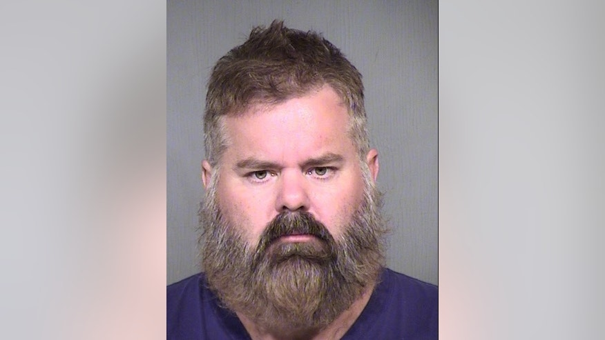 This undated photo provided by Maricopa County Sheriff's Office shows Brent Farley. The 43-year-old Farley is facing one count each of disorderly conduct and criminal trespassing.  Authorities would not comment Thursday, Aug. 6, 2015, on whether a group of armed bounty hunters who mistakenly swarmed the Phoenix police chief's home were the victims of a prank. (Maricopa County Sheriff's Office via AP)