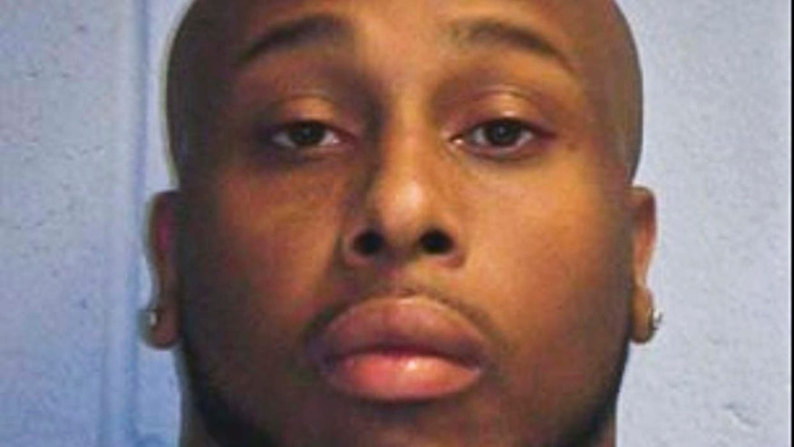 This photo provided by the New Jersey State Police, shows Quran Powell, 27 of Holmdel, N.J.