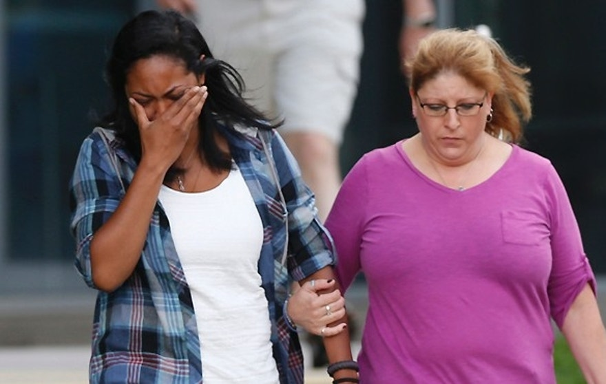 Lasamoa Cross, left, wipes tears from her face as she leaves the Arapahoe County Courthouse with Theresa Hoover, the mother of her boyfriend, Alexander J. Boik, who was killed in the theatre massacre Friday, Aug. 7, 2015, in Centennial, Colo. Jurors failed to agree on a death sentence for Colorado theater shooter James Holmes, prompting shocked sobs from victims, police officers and his own mother. (AP Photo/David Zalubowski)