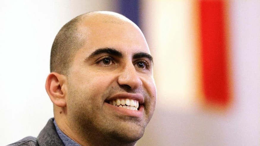 FILE - In this Sept. 9, 2014, file photo, Steve Salaita, a professor who lost a job offer from the University of Illinois over dozens of profane, anti-Israel Twitter messages, speaks during a news conference in Champaign Ill. A federal judge ruled Thursday Aug. 6, 2015 that a lawsuit brought by Salaita, whose anti-Israel Twitter messages led the University of Illinois to withdraw a job offer, can continue. U.S. District Judge Harry D. Leinenweber dismissed four of Steven Salaita's accusations but decided that the bulk of his case could go on. (AP Photo/Seth Perlman, File)