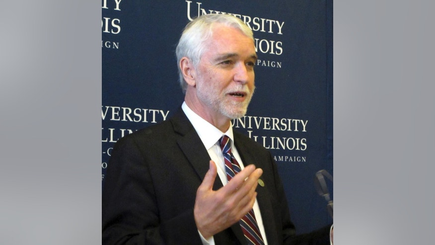 In this May 18, 2015 photo, University of Illinois President Timothy Killeen speaks to reporters in his office on the Urbana, Ill., campus. The university announced Friday, Aug. 7, 2015,  that several administrators, including outgoing Chancellor Phyllis Wise, violated school policy by using private emails to hide correspondence from public view. Those emails included discussions about controlling the damage from a controversy spurred by the revocation of a job offer to a professor who sent anti-Israel tweets. (AP Photo/David Mercer)