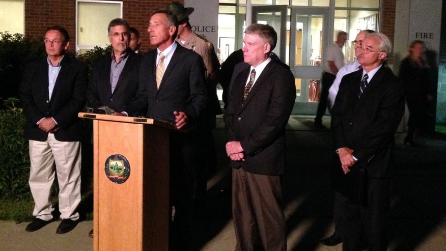 In this Saturday, Aug. 8, 2015, photo, Vermont Gov. Peter Shumlin, at podium, and other officials brief the media on the deaths of four people a day earlier in Barre, Vt. Authorities say Jody Herring shot and killed state social worker Lara Sobel, who had handled a case in which Herring's 9-year-old daughter had been removed from her home. On Saturday, the bodies of three of Herring's relatives were found at the family home in neighboring Berlin. (AP Photo/Dave Gram)