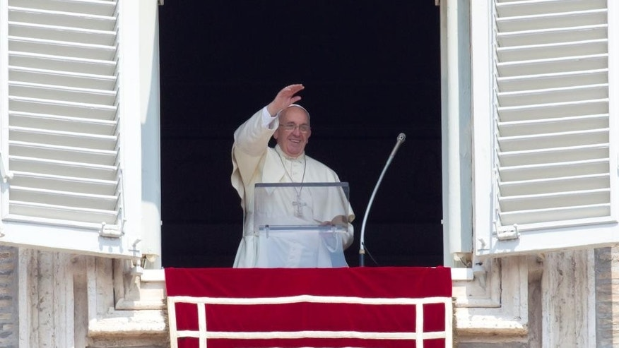 "Pope Francis waves to the faithful as he arrives to recite the Angelus noon prayer from his studio window overlooking St. Peter's Square at the Vatican, Sunday, Aug. 9, 2015. Pope Francis said the detonation of atomic bombs at Hiroshima and Nagasaki 70 years ago remains ""a permanent warning to humanity"" to reject war and ban weapons of mass destruction. (AP Photo/Riccardo De Luca)"