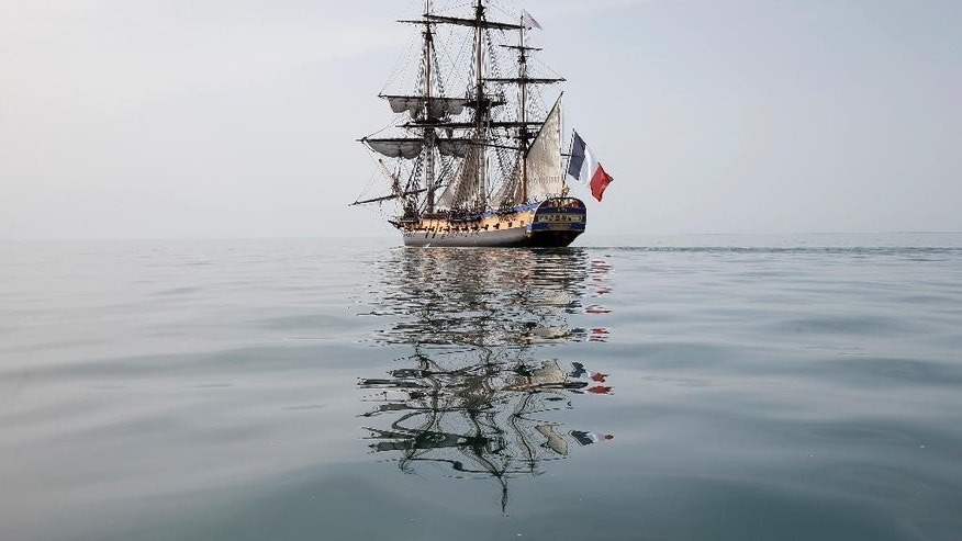 FILE - In this April 15, 2015 file photo, the three masts frigate Hermione sails at La Rochelle, southwest France, as part of preparation of a trip to America. After nearly four months crossing the Atlantic twice and visiting ports along the U.S. East Coast, the replica of an American Revolution-era tall ship is coming home to France, Monday Aug.10, 2015.  (AP Photo/Francois Mori, File)