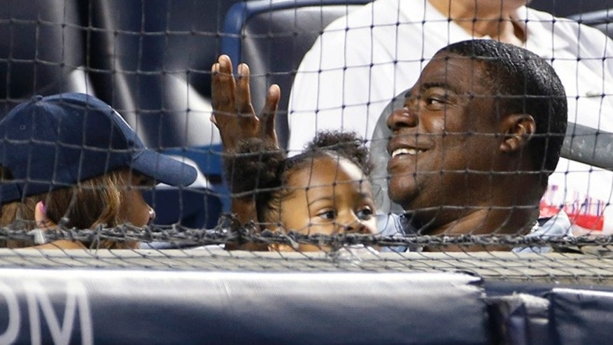 Aug. 4: Tracy Morgan, lower right, sits in the first row behind home plate at the New York Yankees' baseball game against the Boston Red Sox at Yankee Stadium.
