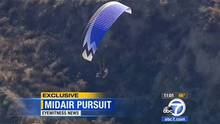 Monday, Aug. 10, 2015: In a frame from video provided by KABC-TV/abc7.com, Ron Nagin, the paraglider pilot, soars near Los Angeles County's Pitchess Detention Center. Jail deputies saw the fly-by and a Los Angeles County Sheriff's helicopter began following him.