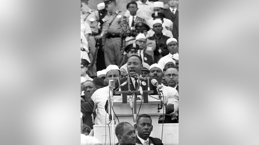 "In this Aug. 28, 1963 photo, The Rev. Dr. Martin Luther King Jr., head of the Southern Christian Leadership Conference, gestures during his ""I Have a Dream"" speech as he addresses thousands of civil rights supporters gathered in Washington, D.C. Months before the Rev. Martin Luther King Jr. delivered his famous ""I Have a Dream"" speech to hundreds of thousands of people gathered in Washington in 1963, he fine-tuned his civil rights message before a much smaller audience in North Carolina. Reporters had covered King's 55-minute speech at a high school gymnasium in Rocky Mount on Nov. 27, 1962, but a recording wasn't known to exist until English professor Jason Miller found an aging reel-to-reel tape in the town's public library. (AP Photo)"