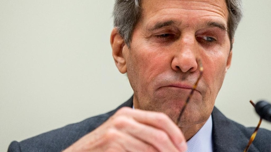 FILE - In this July 28, 2015 file photo, Secretary of State John Kerry pauses while testifying on Capitol Hill in Washington before the House Foreign Affairs Committee hearing on the Iran Nuclear Agreement.   Kerry says if Congress rejects the Iran nuclear deal, the U.S. won't be able to prevent allies from doing business with Tehran.  (AP Photo/Andrew Harnik)