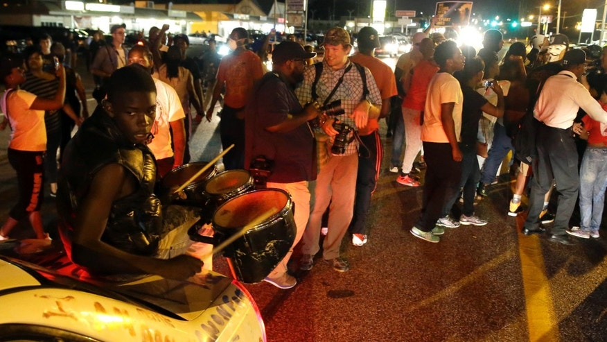 Aug. 11, 2015: Protesters gather along West Florissant Avenue during a demonstration in Ferguson, Mo.