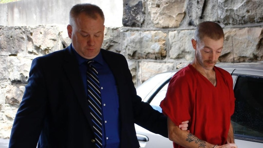 Robert Crissman Jr., right, is escorted to his preliminary hearing at the Armstrong County Courthouse, Wednesday, Aug. 12, 2015, in Kittanning, Pa. Crissman is accused of escaping from the Kittanning jail on July 30, 2015, and killing an acquaintance while on the run. (AP Photo/Keith Srakocic)