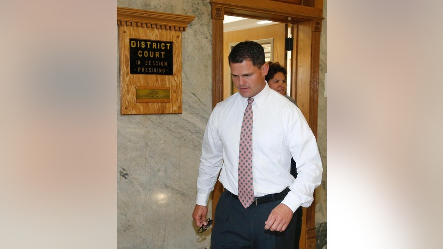 Eric Roberts leaves a courtroom following an appearance in Sapulpa, Okla., Wednesday, Aug. 12, 2015. Roberts, an ex-Oklahoma Highway Patrol trooper charged with rape and sexual battery of three women during traffic stops, has pleaded not guilty. (AP Photo/Sue Ogrocki)