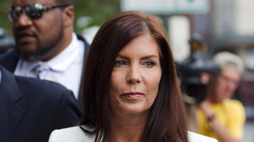 FILE - In this Aug. 8, 2015, file photo, Pennsylvania Attorney General Kathleen Kane arrives to be processed and arraigned on charges she leaked secret grand jury material and then lied about it under oath at the Montgomery County detective bureau in Norristown, Pa. Kane has scheduled a news conference for Wednesday, Aug. 12, at the state Capitol to publicly discuss the criminal charges leveled against her last week in connection with an alleged political payback scheme. (AP Photo/Laurence Kesterson, File)