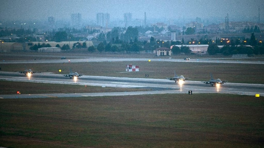 In this image provided by the U.S. Air Force, four F-16 Fighting Falcon prepare to take off from Incirlik Air Base, Turkey, as the U.S. on Wednesday, Aug. 12, 2015, launched its first airstrikes by Turkey-based F-16 fighter jets against Islamic State targets in Syria, marking a limited escalation of a yearlong air campaign that critics have called excessively cautious.  (Krystal Ardrey/U.S. Air Force via AP))