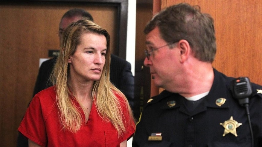 Jody Herring is led out of court after her arraignment  in Vermont Superior Court in Barre, Vt., Monday, Aug. 10, 2015. The Vermont woman charged with killing a social worker because she was upset about losing custody of her 9-year-old daughter pleaded not guilty on Monday and was ordered held without bail. (Toby Talbot/Times Argus via AP, Pool)