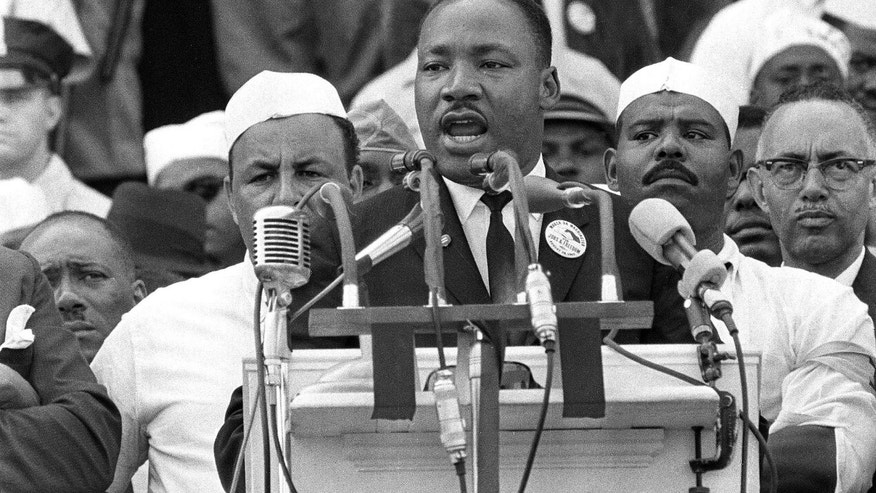"Aug. 28, 1963: The Rev. Dr. Martin Luther King Jr., head of the Southern Christian Leadership Conference, gestures during his ""I Have a Dream"" speech as he addresses thousands of civil rights supporters gathered in Washington, D.C."