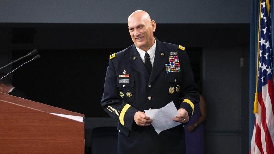 Outgoing Army Chief of Staff Gen. Ray Odierno arrives to speak at his final news briefing, Wednesday, Aug. 12, 2015, at the Pentagon. (AP Photo/Evan Vucci)