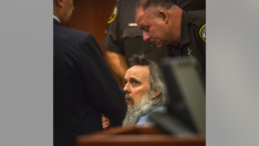 Charles Severance listens to his attorney during a pretrial hearing for his upcoming murder trial, Thursday, Aug., 13, 2015, in Fairfax, Va. Lawyers for Severance, charged with killing three Alexandria residents over a 10-year span, said Thursday their client is innocent and that his mental illness and paranoia made him the target of unfounded suspicions. At the pretrial hearing, lawyers for Severance won the right to tell jurors about Severance's mental illness at his upcoming trial.  (Bill O'Leary/The Washington Post via AP, Pool)