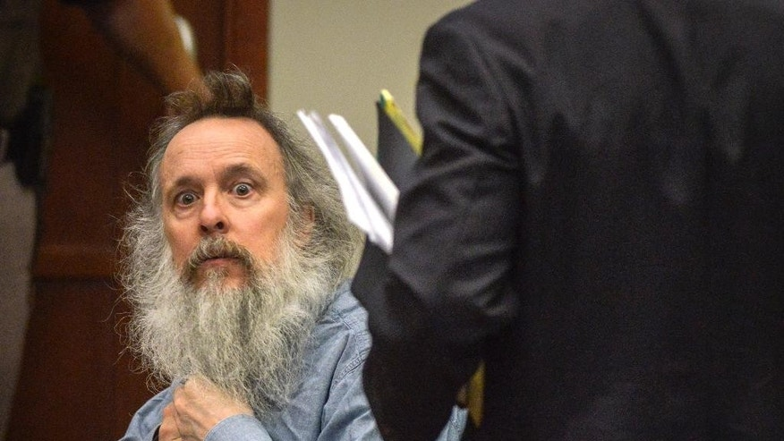 Charles Severance prepares to leave the courtroom after a pretrial hearing for his upcoming murder trial, Thursday, Aug., 13, 2015, in Fairfax, Va. Lawyers for Severance, charged with killing three Alexandria residents over a 10-year span, said Thursday their client is innocent and that his mental illness and paranoia made him the target of unfounded suspicions. At the pretrial hearing, lawyers for Severance won the right to tell jurors about Severance's mental illness at his upcoming trial.  (Bill O'Leary/The Washington Post via AP, Pool)