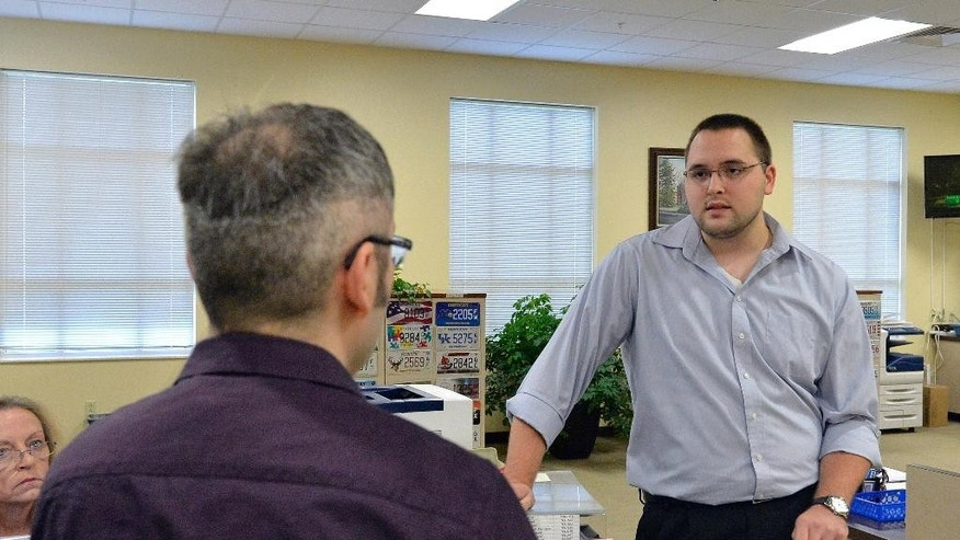 Rowan County clerk Nathan Davis, right, informs David Moore that the clerk's office will not be issuing marriage licenses, in defiance of an order from a federal judge, in Morehead, Ky., Thursday, Aug. 13, 2015. Rowan County Clerk Kim Davis has already filed a notice of appeal and plans to request a stay on the ruling. (AP Photo/Timothy D. Easley)