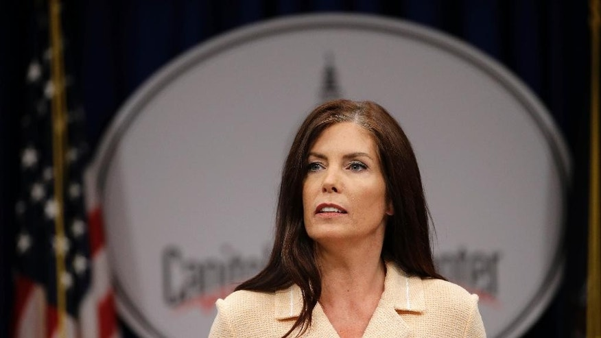 Pennsylvania Attorney General Kathleen Kane speaks during a news conference, Wednesday, Aug. 12, 2015, at the state Capitol in Harrisburg, Pa. Kane said that criminal charges against her are part of an effort by state prosecutors and judges to conceal pornographic and racially insensitive emails they circulated with one another. Kane is charged with leaking grand jury information to a newspaper reporter as payback to a former state prosecutor and then lying about it under oath. (AP Photo/Matt Rourke)