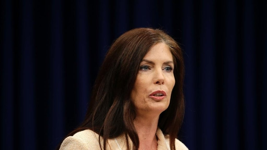 Pennsylvania Attorney General Kathleen Kane speaks during a news conference Wednesday, Aug. 12, 2015, at the state Capitol in Harrisburg, Pa. Kane said Wednesday that criminal charges threatening to end her career were filed as part of an effort by state prosecutors and judges to conceal pornographic and racially insensitive emails they circulated with one another. Kane was charged last week with leaking grand jury information to a newspaper reporter as payback to a former state prosecutor and then lying about it under oath. (AP Photo/Matt Rourke)