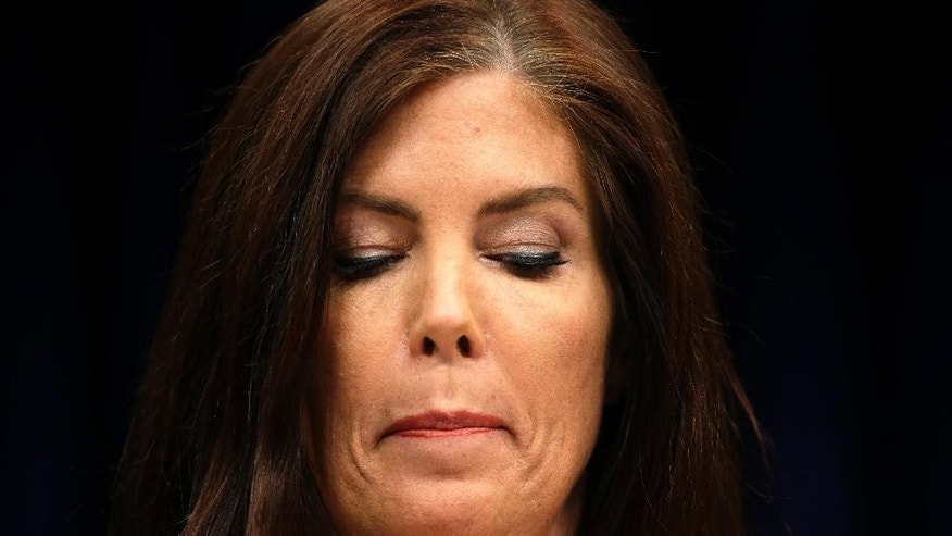Pennsylvania Attorney General Kathleen Kane looks down as she reads a statement during a news conference Wednesday, Aug. 12, 2015, at the state Capitol in Harrisburg, Pa. Kane said Wednesday that criminal charges threatening to end her career were filed as part of an effort by state prosecutors and judges to conceal pornographic and racially insensitive emails they circulated with one another. Kane was charged last week with leaking grand jury information to a newspaper reporter as payback to a former state prosecutor and then lying about it under oath.   (AP Photo/Matt Rourke)