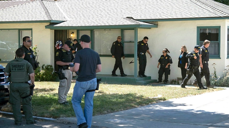 Aug. 14, 2015: Officers are on scene at the home of attorney Frank Carson in Turlock, Calif.