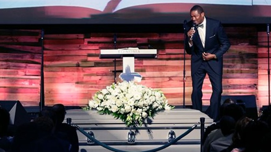 Aug. 15, 2015: Pastor Ronnie Goines gives the eulogy during funeral services for Christian Taylor, 19, at the Koinonia Christian Church in Arlington, Texas. The black college football player was fatally shot by a North Texas police officer answering a burglary call at a car dealership.