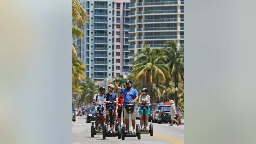 In this, Saturday, Aug. 8, 2015 photo, tourists take a Segway tour of South Beach, in Miami Beach, Fla. European visitation to Florida was up 6 percent from 2013 to 2014, the most recent totals available. About 4 million Europeans visited the state, according to Visit Florida, the state's tourism agency. Florida beach tourism leaders say they are getting a boost in European visitors this summer because of the turmoil in Greece and the Middle East. (AP Photo/Wilfredo Lee)