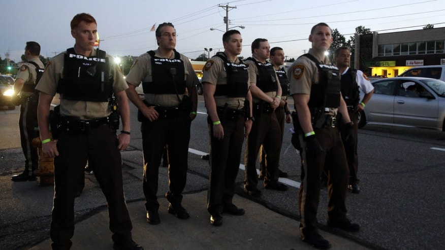 Aug. 10, 2015: Police patrol in Ferguson, Mo