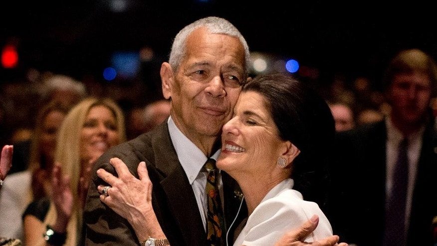 "FILE- In this April 10, 2014, file photo, social activist Julian Bond hugs Luci Baines Johnson, the younger daughter of President Lyndon Baines Johnson after singing ""We Shall Overcome"" during the Civil Rights Summit to commemorate the 50th anniversary of the signing of the Civil Rights Act in Austin, Texas. Bond, a civil rights activist and longtime board chairman of the NAACP, died Saturday, Aug. 15, 2015, according to the Southern Poverty Law Center. He was 75. (AP Photo/Carolyn Kaster File)"