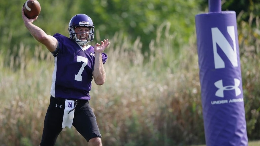 Northwestern football player Matt Alvita throws during practice at the University of Wisconsin-Parkside campus on Monday, Aug. 17, 2015, in Kenosha, Wi. (AP Photo/Jeffrey Phelps)