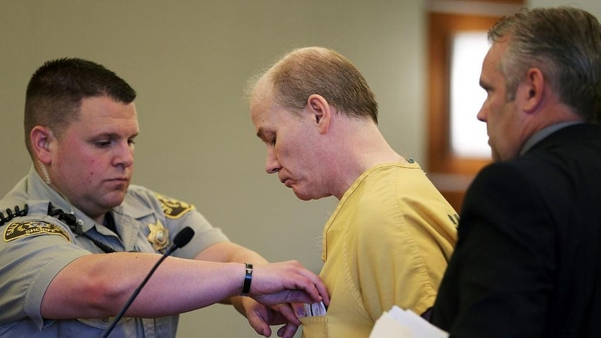 Troy Morley receives paperwork from a bailiff after pleading guilty to child kidnapping in 3rd District Court, Monday, Aug. 17, 2015, in West Jordan, Utah. Morley told police he entered a home through an unlocked door, convinced a girl to come with him and tried to walk out of the house with her in his arms on Nov. 7, 2014. The girl's father convinced Morley to let her go. (Ravell Call/The Deseret News via AP, Pool)
