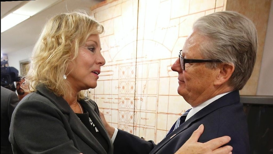 Debbie Ziegler, the mother of Brittany Maynard, talks with Sen. William Monning D-Carmel after a news conference to announce the reintroduction of right to die legislation, at Tuesday, Aug. 18, 2015, in Sacramento,Calif.  Monning, along with Sen. Lois Wolk, D-Davis, Assemblywoman Susan Talamantes Eggman, D-Stockton and other lawmakers have reintroduced legislation  that would have allowed terminally ill patients to take life ending drugs.  A nearly identical bill  failed to get out of a legislative committee earlier this year. Maynard, the 29-year-old California woman with brain cancer, moved to Oregon to legally end her life last fall. (AP Photo/Rich Pedroncelli)